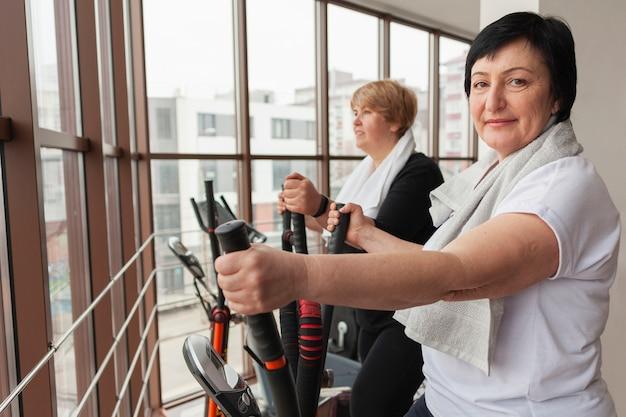 Senior smiley women on treadmill