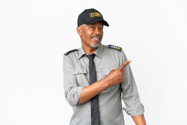 Senior staff man isolated on white background pointing back