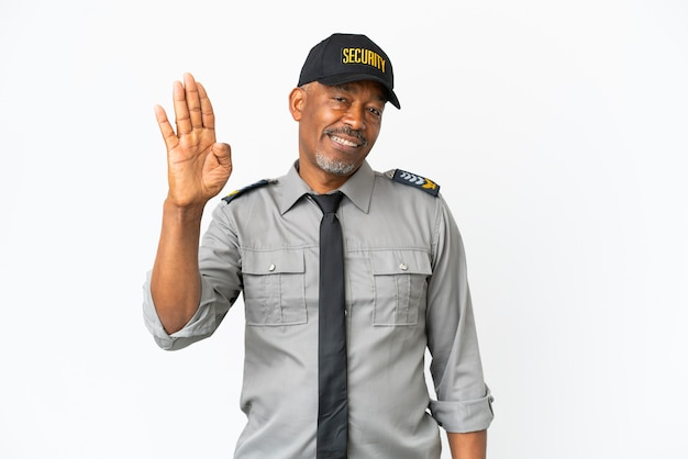 Senior staff man isolated on white background saluting with hand with happy expression