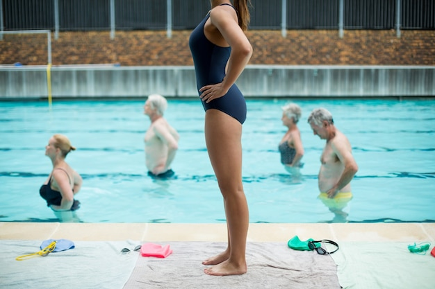 Senior swimmers following female trainer