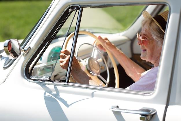 Senior traveler wearing red sunglasses
