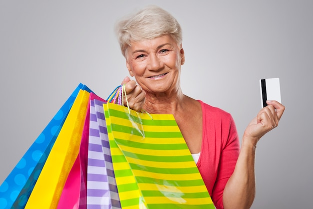 Senior woman always paying for shopping by credit card