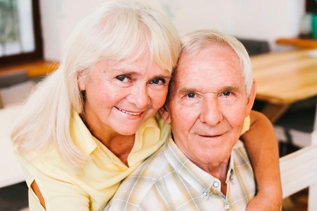 Senior woman bonding aged man at home