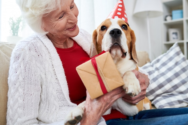 Senior woman celebrating her dogs birthday