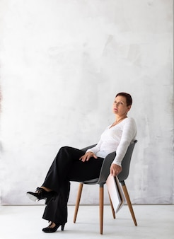 Senior woman on a chair thinking