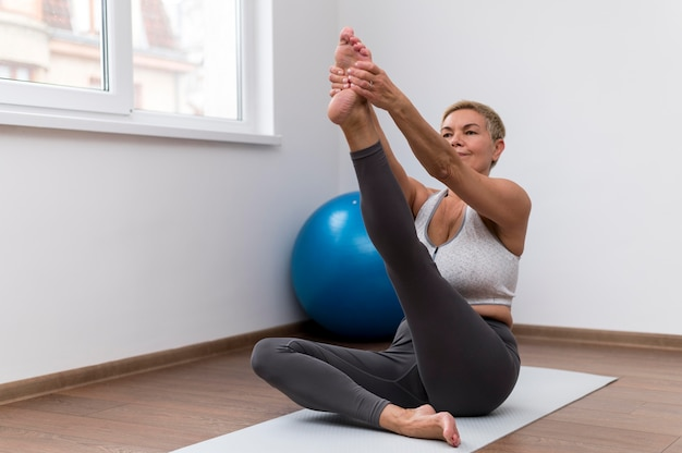 Senior woman doing exercises at home