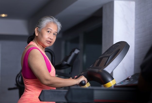 Senior woman exercise at fitness gym