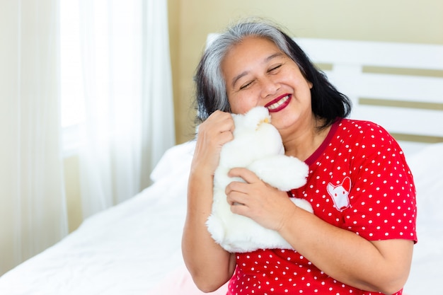Senior woman happy with teddy bear