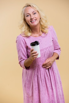 Senior woman holding a cup of coffee