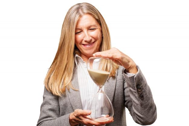 Senior woman holding an hourglass