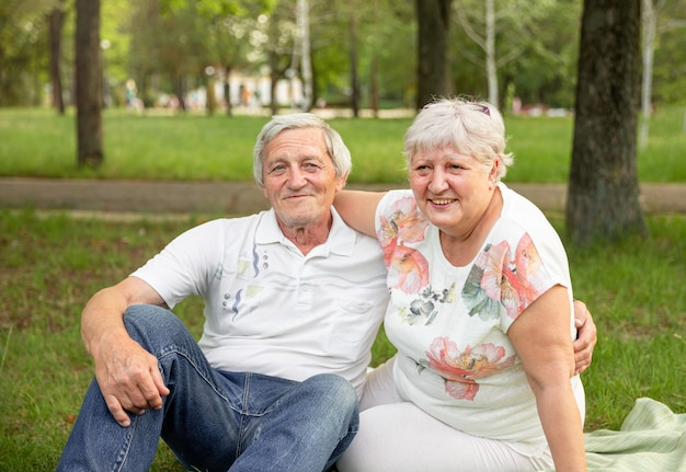 Senior woman hugging her partner and laughing together. senior couple having fun and embracing.