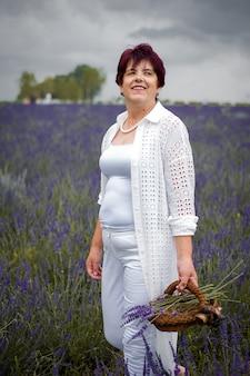 Senior woman on the lavender field