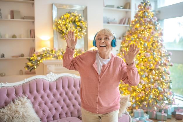 Senior woman listening to music in headphones