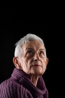 Senior woman looking up