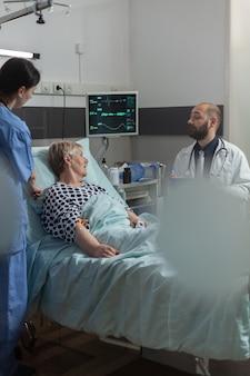 Senior woman patient getting treament through intravenous line