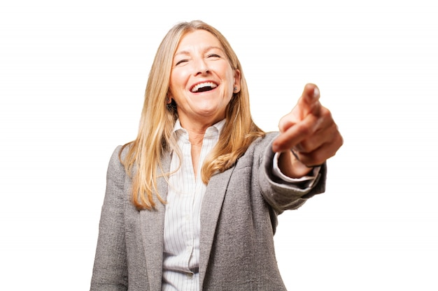 Senior woman pointing and laughing