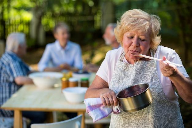 Senior woman preparing jam