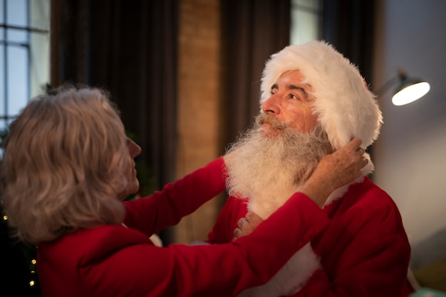 Senior woman setting up santa claus