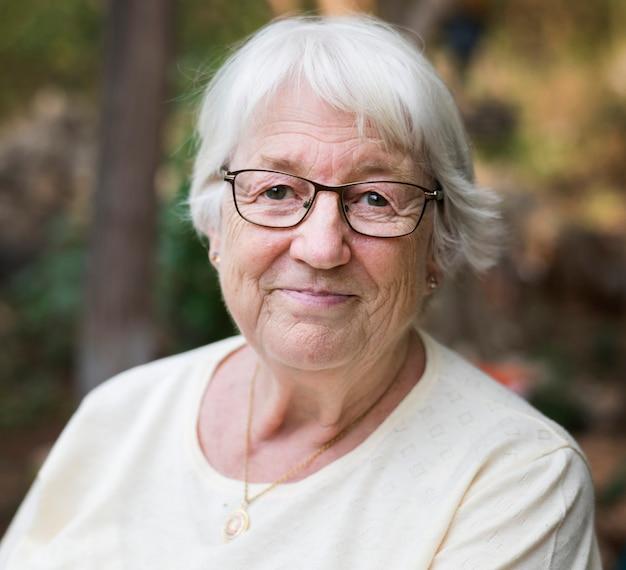 Senior woman sitting alone outdoors