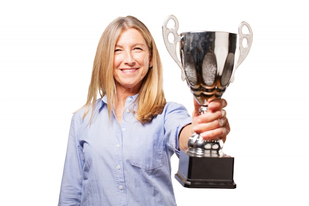 Senior woman smiling with a trophy