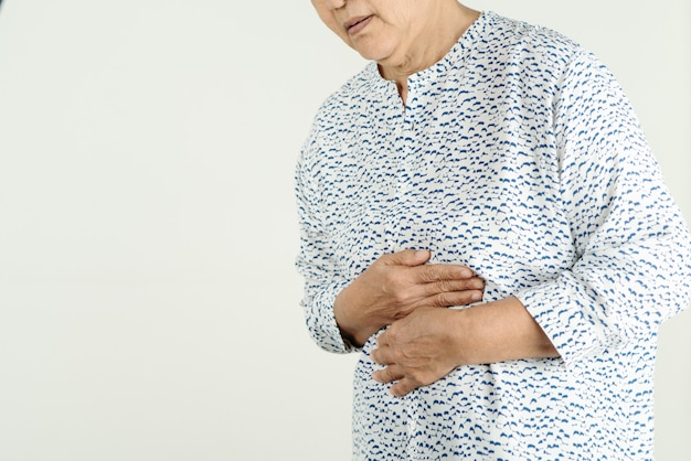 Senior woman suffering from acid reflux or heartburn