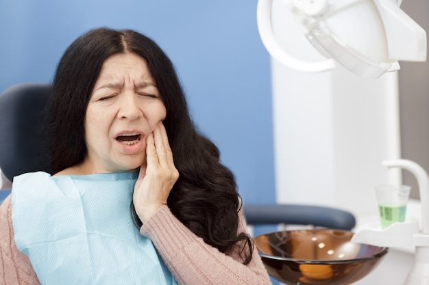 Senior woman suffering from toothache
