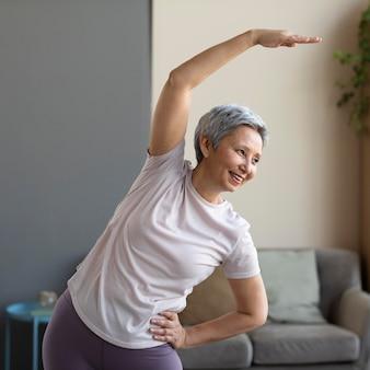 Senior woman training at home
