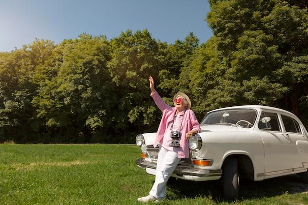 Senior woman traveling alone and having fun