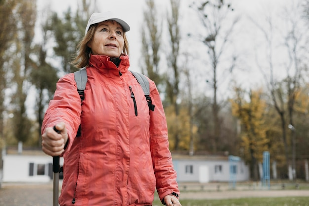 Senior woman trekking outdoors