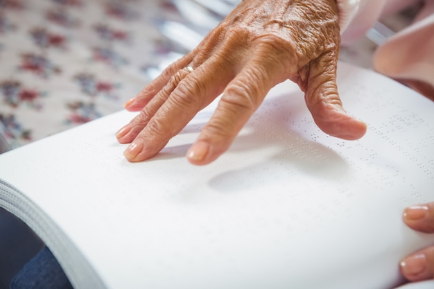 Senior woman using braille to read