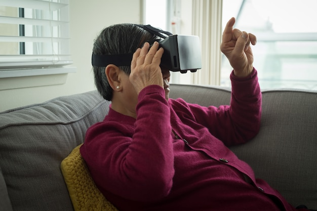 Senior woman using vr glasses