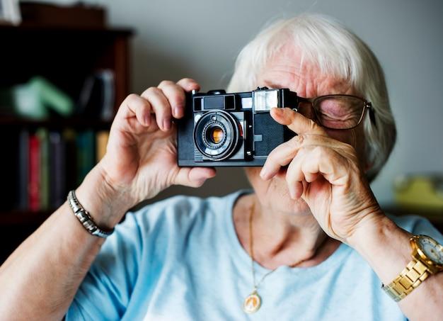 Senior woman utaking a picture