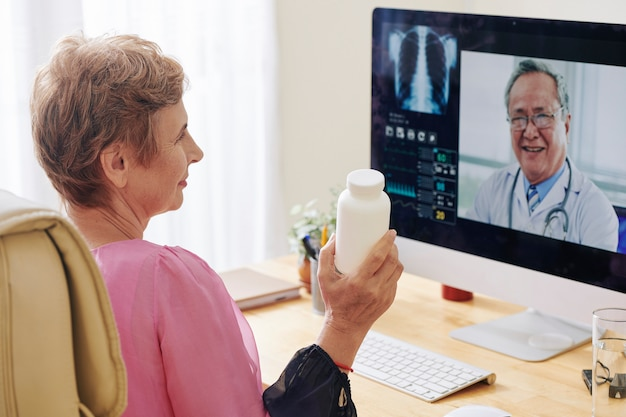 Senior woman video calling doctor