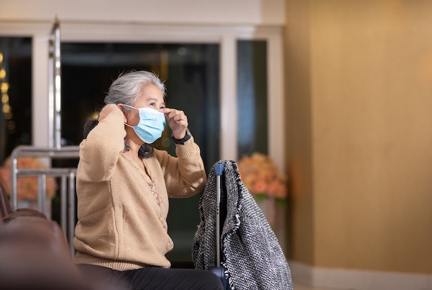 Senior woman wearing protective face mask