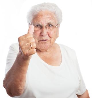 엄지 손가락으로 고위 여자
