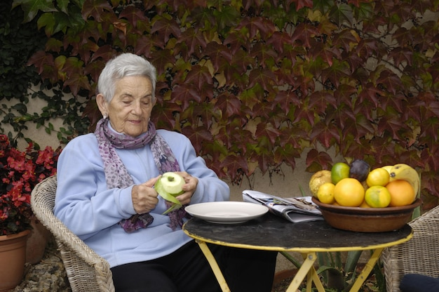 Senior  woman with a apple