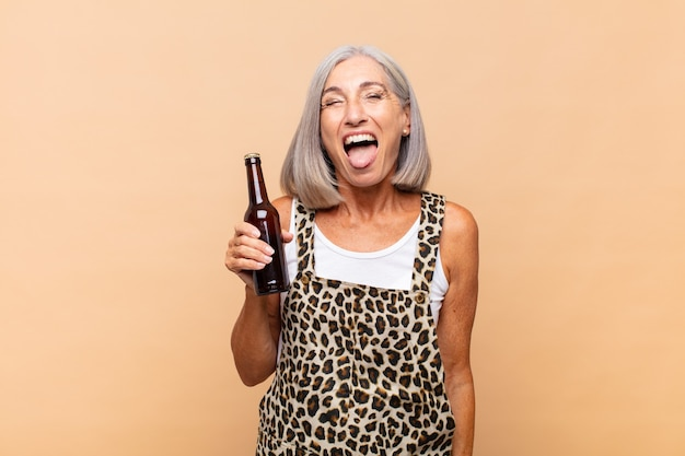 Senior woman with a beer