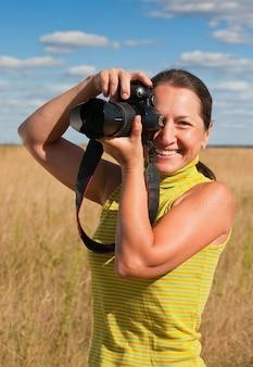 Senior woman with photocamera