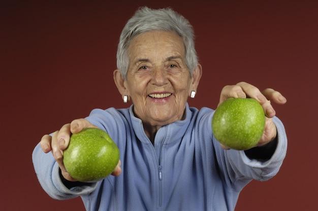Senior womanwith apple