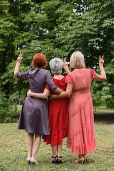 Senior women celebrating friendship in the park