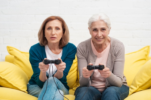 Senior women playing video games