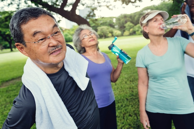 Seniors exercising in the park