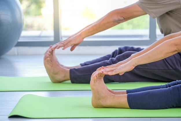 Seniors performing yoga in a studio
