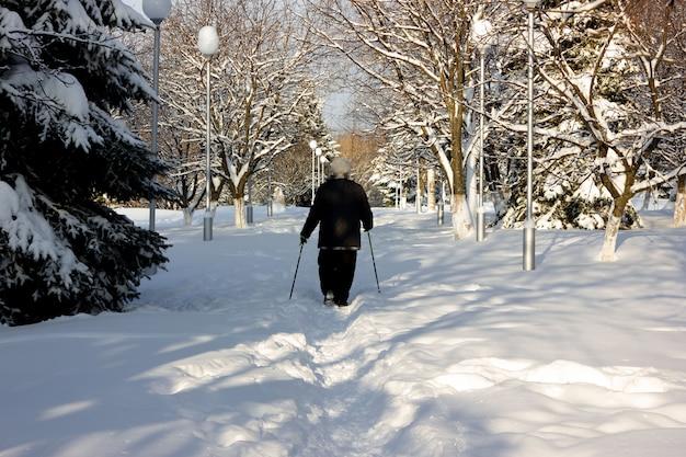 Seniour walking in winter park