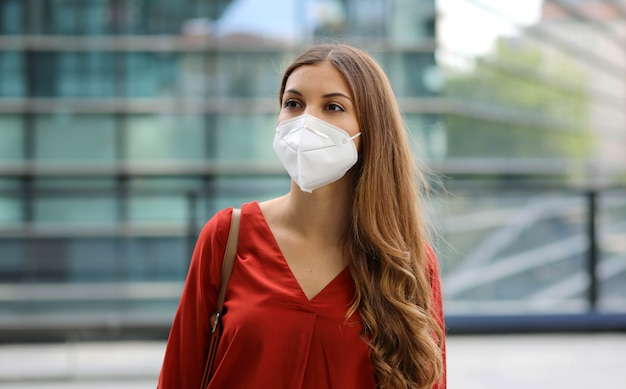 Sense of bewilderment. young woman in empty city street wearing protective mask.