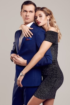 Sensual beautiful young couple dressed in formal clothes