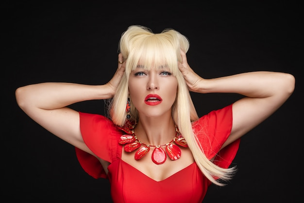 Sensual blonde woman with red lips