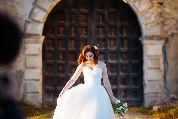 Sensual bride embracing on the background of old wooden door