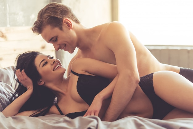 Sensual couple is looking at each other and smiling