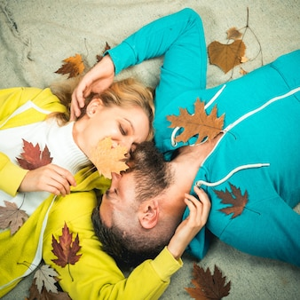 Sensual couple kiss on autumn background colorful autumn and dry leaf ready for text happy couple go...